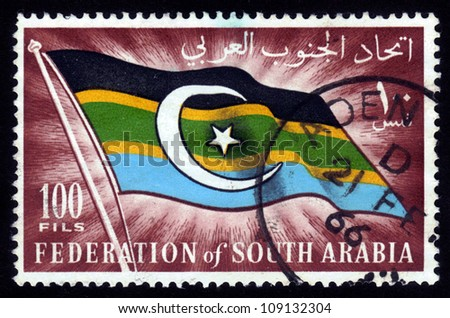 South Arabia - CIRCA 1966: A stamp printed in Federation of South Arabia shows the image of the national flag of Federation of South Arabia, circa 1966 - stock photo