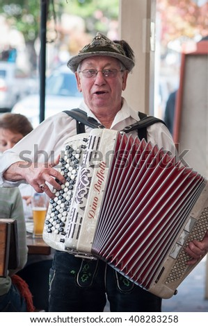 South Australia, Australia - April 06, 2012: A Germany Virtuoso is playing accordion in front of famous restaurant in Hahndorf (Germany Town). - stock photo