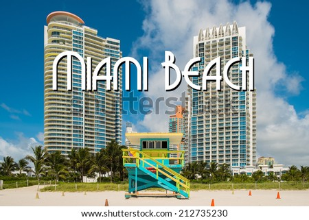 South Beach lifeguard station in Miami Beach with tall condos in the background. - stock photo