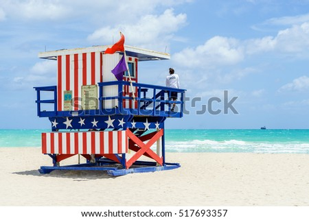 South Beach Miami, Florida, USA - April 17, 2016: Colorful Lifeguard Tower with flags in South Beach. High hazard. Dangerous marine life. Ocean rescue
