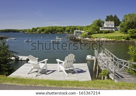 South Bristol aderondack chairs on the coast of Maine. - stock photo