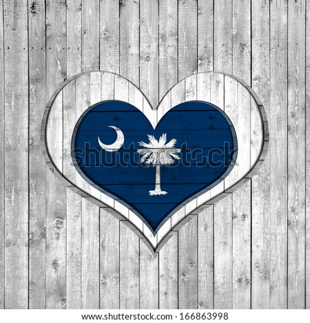 South Carolina flag, wooden background with heart - stock photo