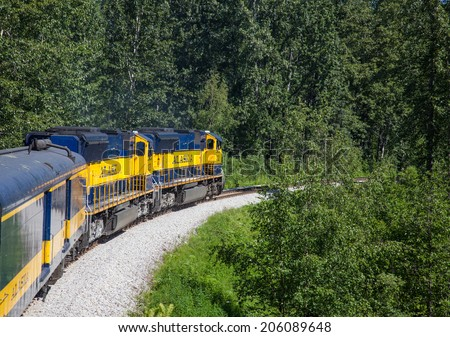 SOUTH CENTRAL ALASKA  JULY 5.  Tourists ride the Alaska Railroad train to Denali National Park on a beautiful sunny day on July 5 in South central Alaska. - stock photo