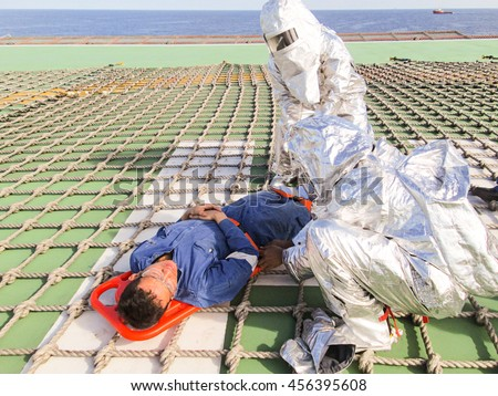 SOUTH CHINA SEA - JUNE 24 : Unidentified offshore people practice rescue casualty drill at the offshore on June 24,2013 in South China Sea, Malaysia.