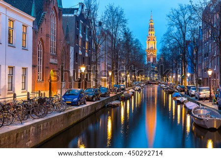 South Church Zuiderkerk and Amsterdam Canals at dusk Netherlands - stock photo