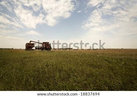 South Dakota farmer off loads soy beans during the Autumn harvest. - stock photo