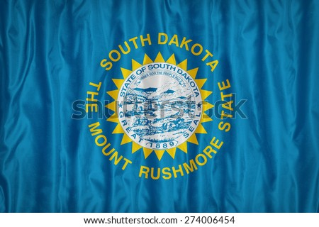 South Dakota flag pattern with a peace on fabric texture,retro vintage style - stock photo