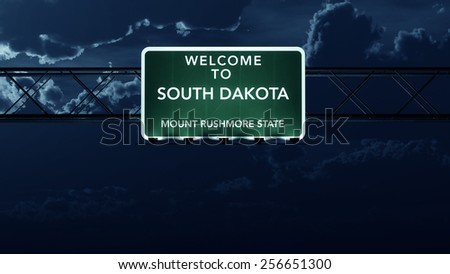 South Dakota USA State Welcome to Interstate Highway Road Sign at Night