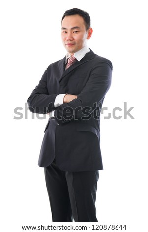 south east asian business man standing chinese ethnicity , crossed arm - stock photo
