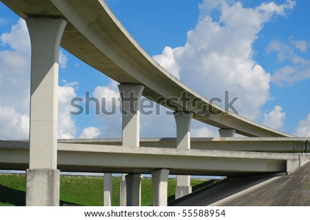 South Florida expressway with blue skies and green grass. - stock photo