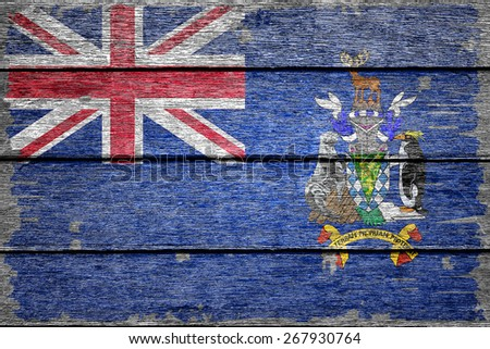 South Georgia and the South Sandwich Islands flag on old wood texture background