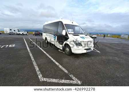 SOUTH ICELAND, ICELAND - SEPTEMBER 07: Reykjavik Tour Bus in Iceland on September 07,2015. Many people come to visit the exotic and beautiful Iceland. - stock photo
