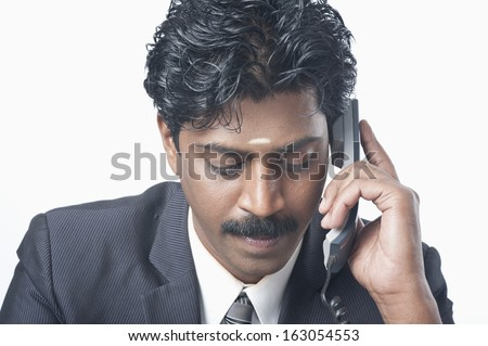 South Indian businessman talking on a phone