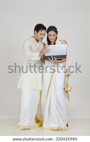 South Indian couple with a laptop