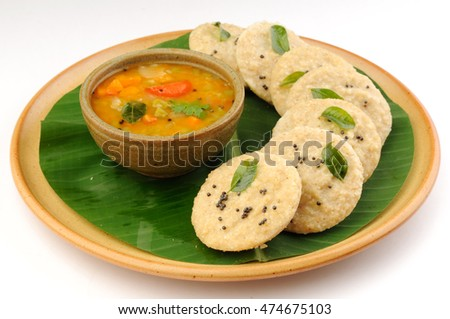 South Indian food, Oats idly and sambar served on banana leaf