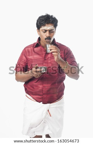 South Indian man having tea