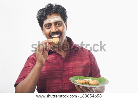 South Indian man having vada