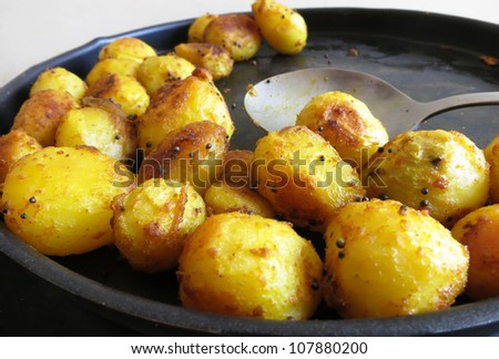 South Indian potato semi-fry or curry. This is a very simple and yummy dish typical to South India - stock photo