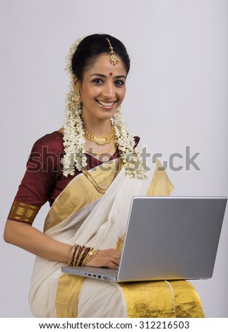 South Indian woman with a laptop