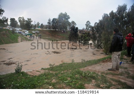 SOUTH ISRAEL JANUARY 18:Flash Flood near Kibbutz Nahal HaBesor on January 18 2010 at the Western Negev, Israel. Flash floods in Israel are deadly people are killed by them each year - stock photo