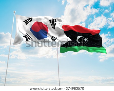 South Korea & Libya Flags are waving in the sky - stock photo
