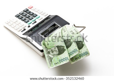 South korea money bills come out from calculator on background