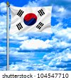 South Korea waving flag against blue sky - stock photo