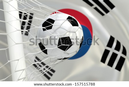 South Korea waving flag and soccer ball in goal net - stock photo