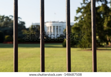 South Lawn view of White House seen through railings Washington DC - stock photo