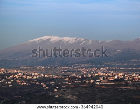 South Lebanon and Dusk with snow on Mt Hermon - stock photo