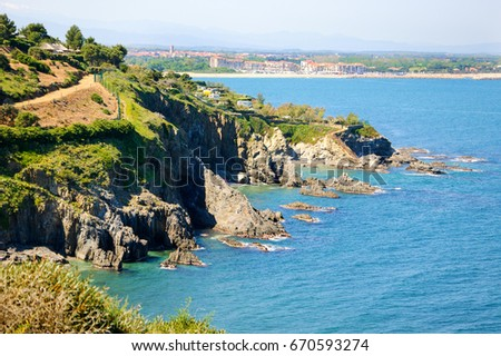 South of France. View from Collioure cliffs to Argeles-sur-Mer beach. Camping on hill. Cote Vermeille. Pyrenees-Orientales, near the border with Spain.
