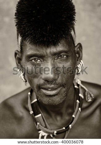 SOUTH OMO - ETHIOPIA - AUGUST 9, 2014: Unidentified Hamer warrior on August 9, 2014 in South Omo, Ethiopia. A 5-year ongoing resettlement program started 2011 threatens the tribes in South Ethiopia - stock photo