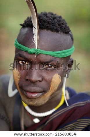 SOUTH OMO - ETHIOPIA - July 23, 2014: Unidentified Mursi man at a ceremony on July 23, 2014 in South Omo, Ethiopia. A 5-year ongoing resettlement program started 2011 threatens the tribes in Ethiopia