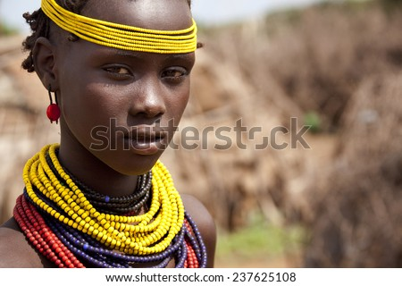 SOUTH OMO - ETHIOPIA - NOVEMBER 23, 2011: Portrait of the unidentified girl from the African tribe Dasanech, in November 23, 2011 in Omo Rift Valley, Ethiopia. - stock photo