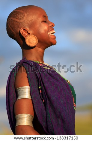 SOUTH OMO - ETHIOPIA - OCTOBER 18, : Unidentified Suri woman at a dance on October 18, 2012 in South Omo, Ethiopia. A 5-year resettlement program started 2011 threatens tribes in Ethiopia. - stock photo