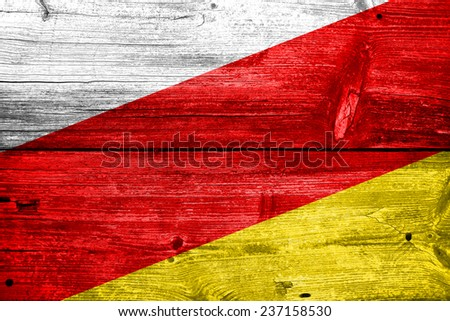 South Ossetia Flag painted on old wood plank texture