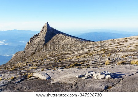 South Peak of Mount Kinabalu located in  Sabah Malaysia Borneo. Mount Kinabalu has been accorded UNESCO World Heritage site and among the most visited mountain in South East Asia. - stock photo