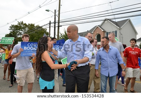 SOUTH PLAINFIELD,NJ-SEPTEMBER 2: Newark NJ Mayor and U.S. Senate candidate Cory Booker greets a parade-goer during the 56th Annual Labor Day Parade on September 2,2013 in South Plainfield,N.J. - stock photo