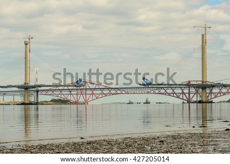 SOUTH QUEENSFERRY, SCOTLAND, UK - MAY 15, 2016: Construction of The Queensferry Crossing a new road bridge built close to the Forth Road Bridge and Forth Bridge spanning the River Forth in Scotland. - stock photo