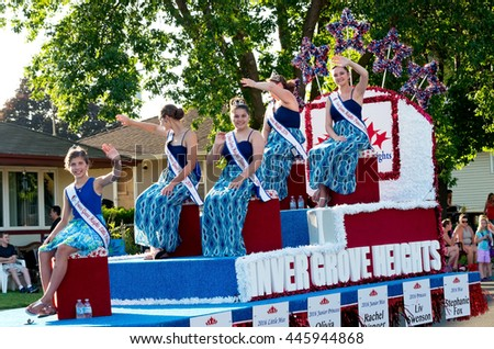 SOUTH ST. PAUL, MINNESOTA - JUNE 24, 2016: Miss Inver Grove Heights Royalty waves to crowd from float during annual South St. Paul Kaposia Days Grande Parade on June 24.  - stock photo