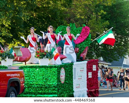 SOUTH ST. PAUL, MINNESOTA - JUNE 24, 2016: North Hudson Wisconsin Pepper Fest Royalty entertains crowd from atop float at annual Kaposia Days Grande Parade in South St. Paul Minnesota on June 24.  - stock photo
