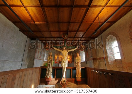 SOUTH TYROL, ITALY - OCTOBER 2013 : The Crucifixion scene, circa 1330, with figures of Mary and John in attendance at Tyrol Castle in the Burggrafenamt, South Tyrol, Italy on 19 october 2013.  - stock photo