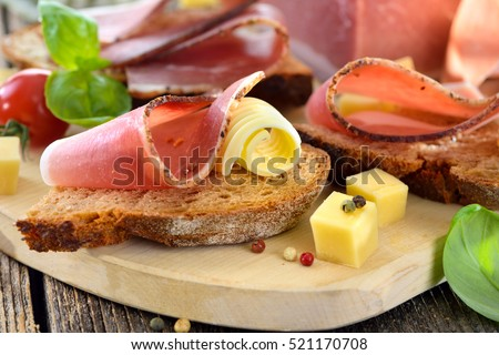 South Tyrolean bacon snack with fresh stone oven baked bread and mountain cheese