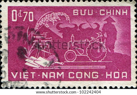 SOUTH VIETNAM - CIRCA 1958: A stamp printed in South Vietnam honoring Agricultural Reform, circa 1958