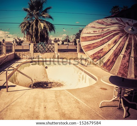 South West American Architectural decay - derelict abandoned swimming pool. - stock photo
