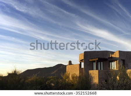 South West desert landscape dramatic sky adobe style architecture - stock photo