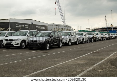SOUTHAMPTON, UK - MAY 31, 2014:  A consignment of vehicles made by BMW in a queue at Southampton Docks. - stock photo