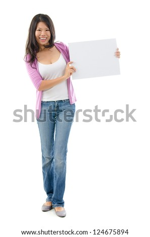 Southeast Asian Chinese woman holding a white placard standing over white background - stock photo