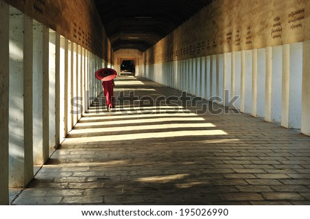 Southeast Asian young little Buddhist monks walking morning alms in bagan, Myanmar - stock photo