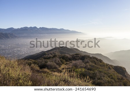 Southern California misty morning hilltop view over Glendale, Eagle Rock and Altadena near Los Angeles.   - stock photo